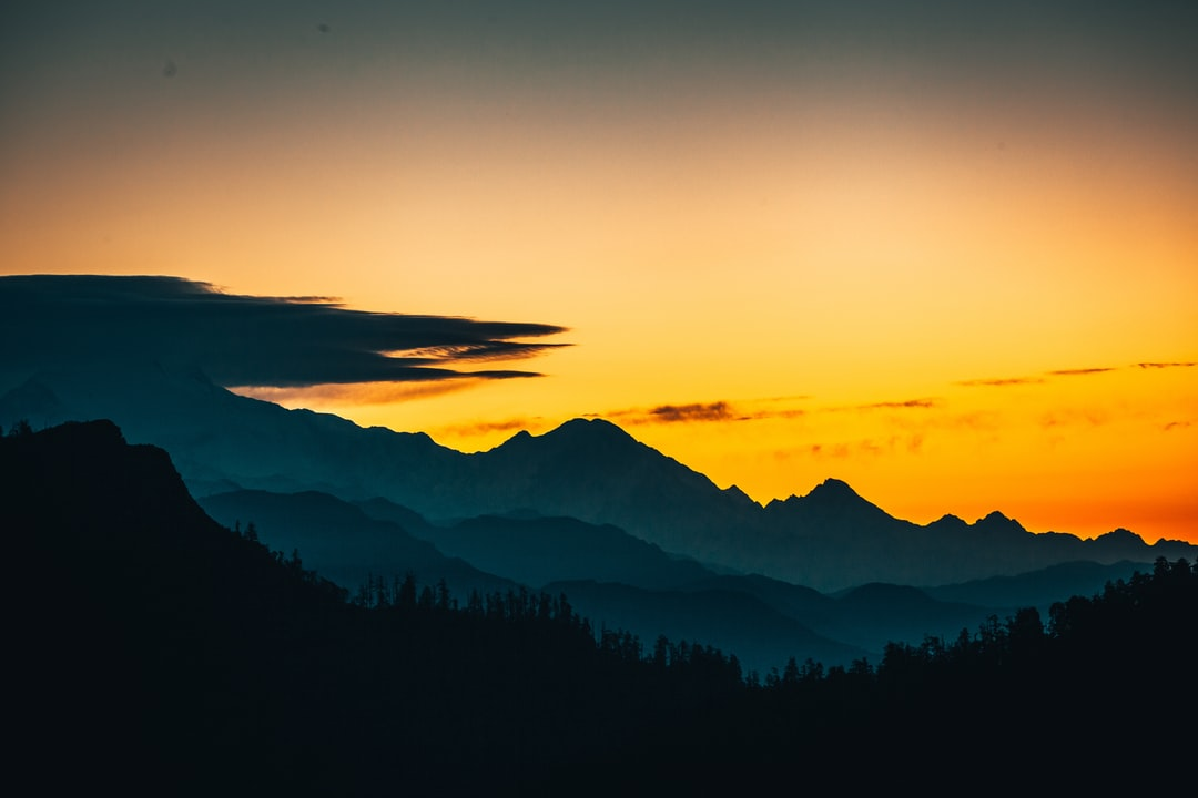 A sunset over a mountain